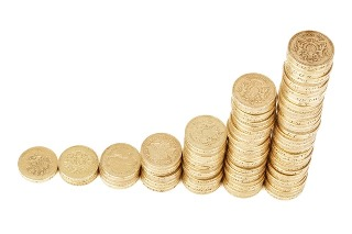 money coins stack wealth 50545